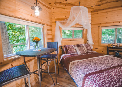 Safari Treehouse interior table and bed