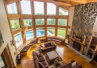 Blissful Ridge Lodge living room pool view