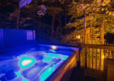 Maple View tree house hot tub at night